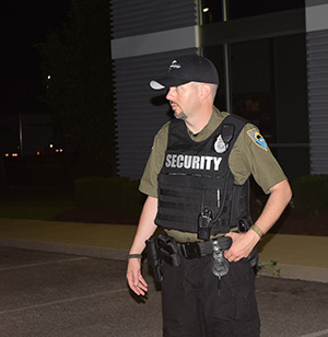 Security Officer ready to escort employees safely to their vehicles