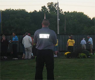 Security officer at neighborhood gathering