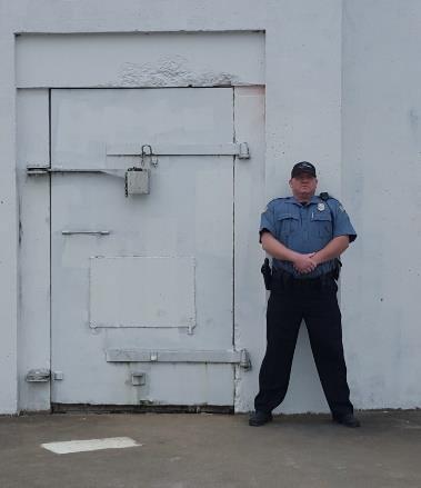 Knighthawk Security guard at warehouse door